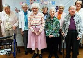The sisters of Lourdes Hall gather for a group photo: from left Sisters Suzanne Buthod, Lois Ann Stoiber, Florence Norton, Winifred Mary Sullivan, Adele Beacham, Rita Clare Gerardot, Emily Walsh and Agnes Maureen Badura